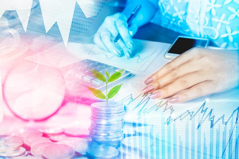 Business woman hand analyzing finance graph, stack of coins,calculator ,business growth concept stock photos