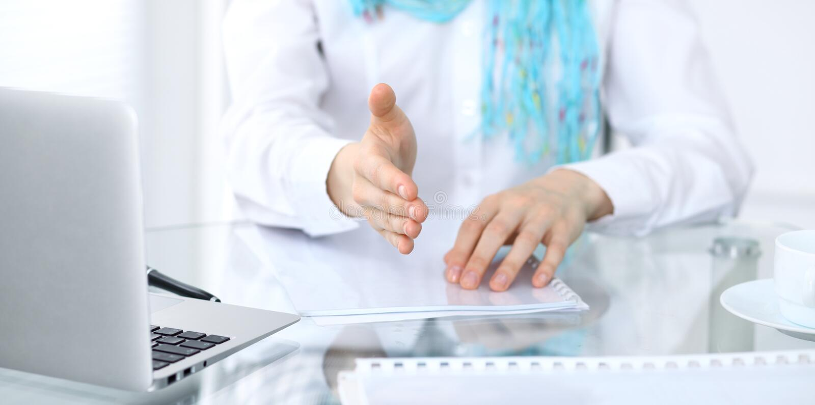 Business woman with hand out for handshake. Close-up of an open hand stock images