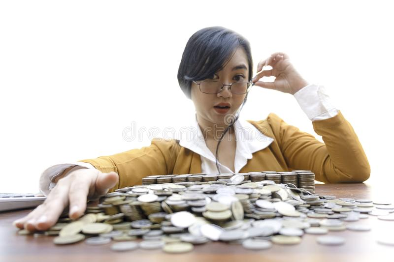 Business woman Hand Protecting With Stacked lots Coin, Portrait of beautiful happy young lady hands Pick up lots money on wooden t royalty free stock photos