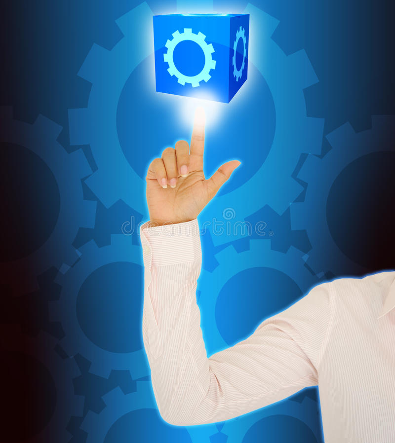 Business woman hand pushing Cog. Business woman hand touch Cog royalty free stock image