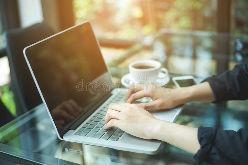 Business woman hand working laptop computer in office stock images