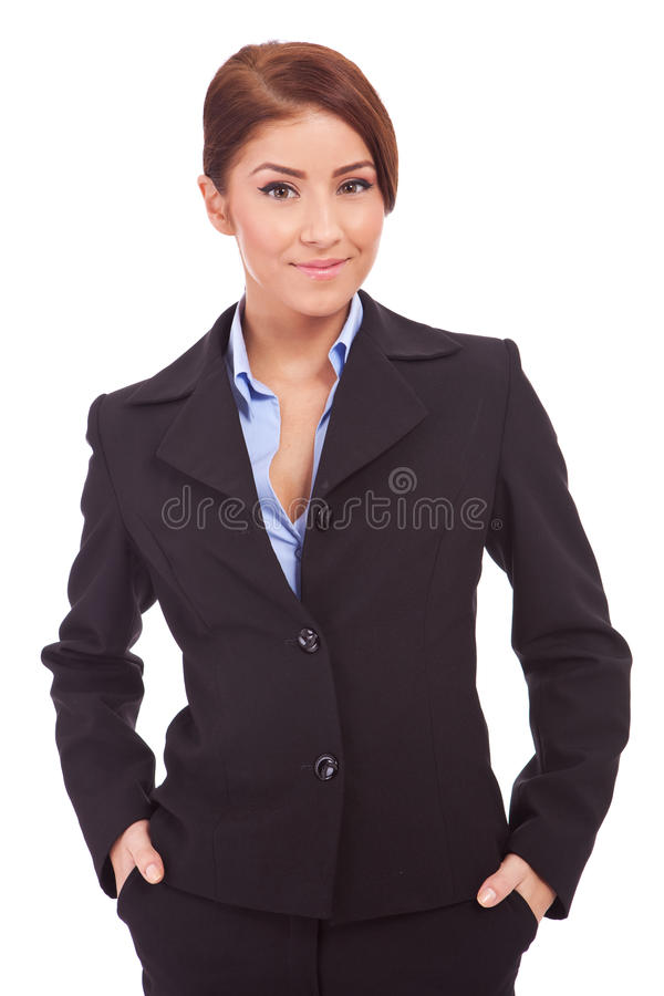 Business woman with hands in her pockets royalty free stock photography