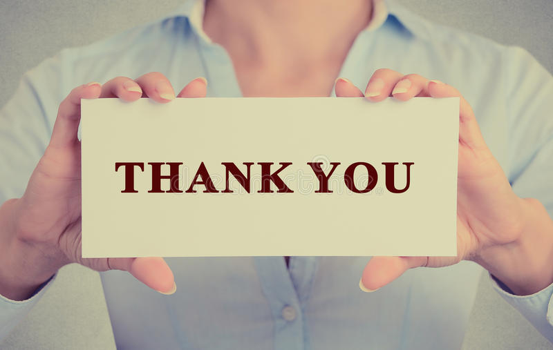 Business woman hands holding sign or card with message thank you royalty free stock image