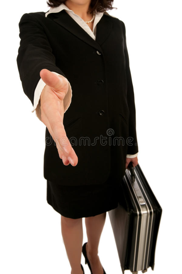 Business Woman Handshake. Business woman with briefcase offering a handshake royalty free stock images