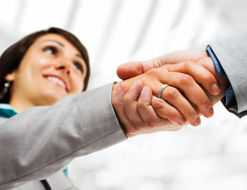 Business woman handshake. Portrait of a business woman giving an handshake royalty free stock image
