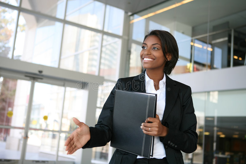 Business Woman Handshake. A pretty african american business woman offering a handshake royalty free stock image