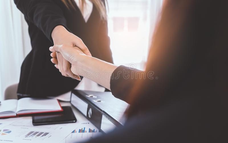Business woman handshaking each other. Over a deal stock photos