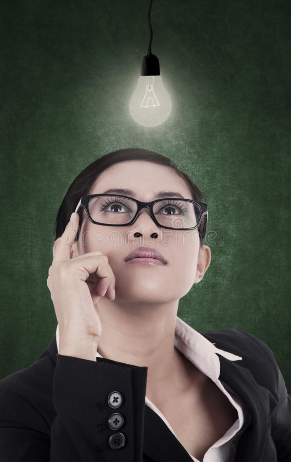 Download Business Woman Having Bright Lit Idea Royalty Free Stock Photography - Image: 27642447