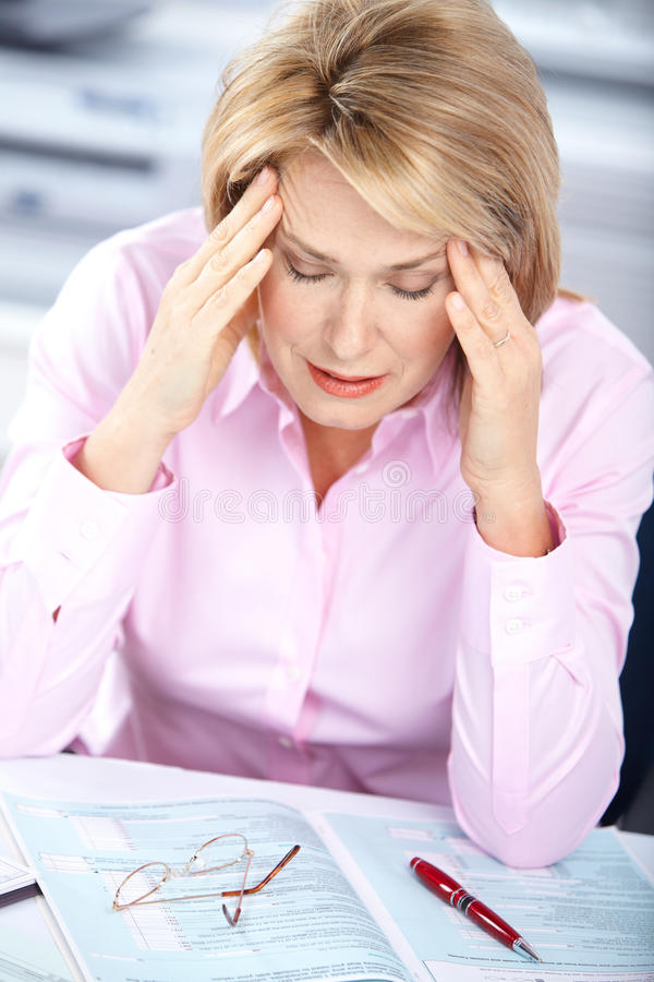 Business woman having stress. In the office royalty free stock photo