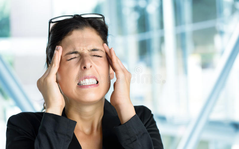 Business woman headache and stress royalty free stock image