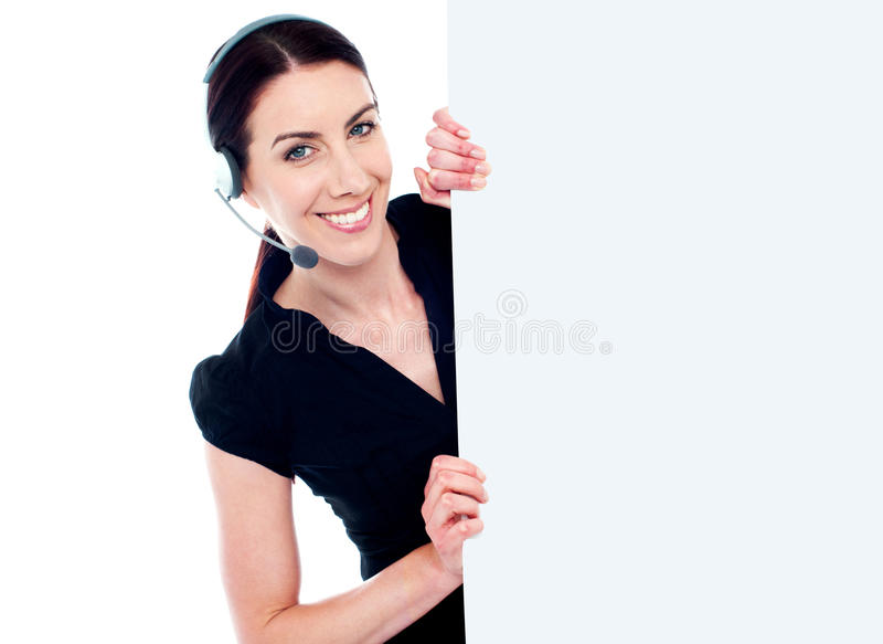 Business woman with headset and banner ad royalty free stock image
