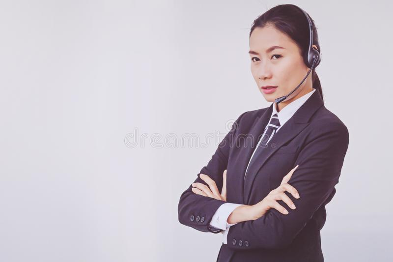 Business woman in headsets. Woman stock image
