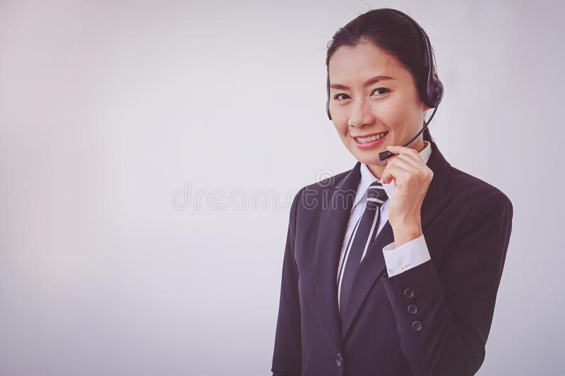 Business woman in headsets. Woman stock photography