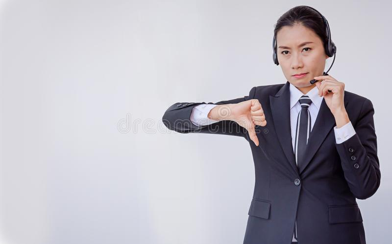 Business woman in headsets. Woman royalty free stock photo