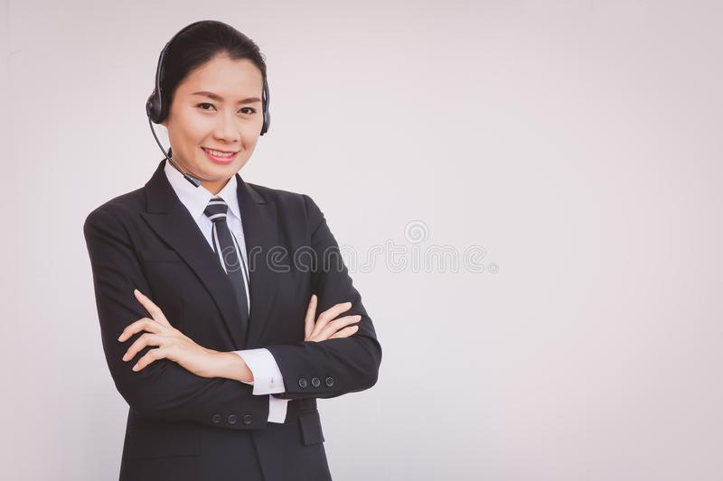 Business woman in headsets. Woman royalty free stock image