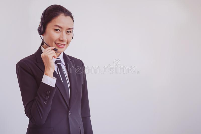 Business woman in headsets. Woman stock images