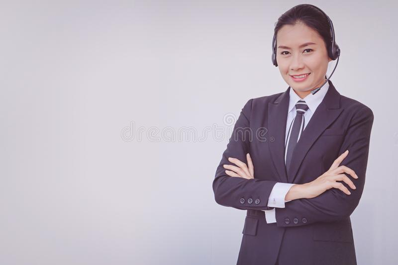 Business woman in headsets. Woman, white, call, background, customer, operator, service, center, isolated, support, phone, female, girl, beautiful, people stock photos