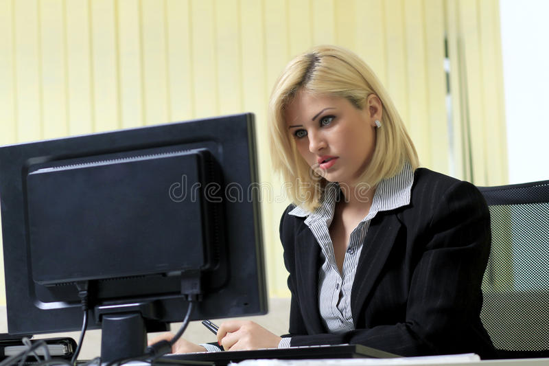 Business woman in her office royalty free stock photography