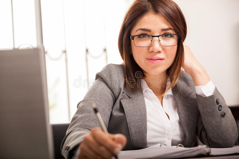 Business woman at her office stock photos