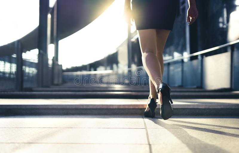 Business woman in high heels walking to work in city street in summer. Elegant and stylish fashion lifestyle. stock images