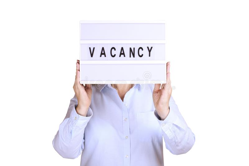 Business woman hold signboard with vacancy text on it. Recruitment and hiring concept.  stock photo