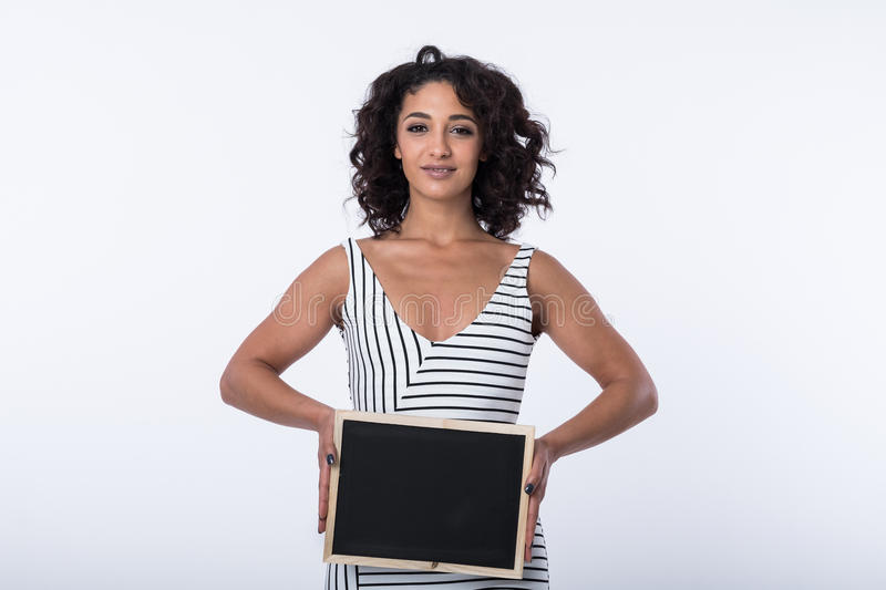 Business woman holding blank chalkboard stock photo