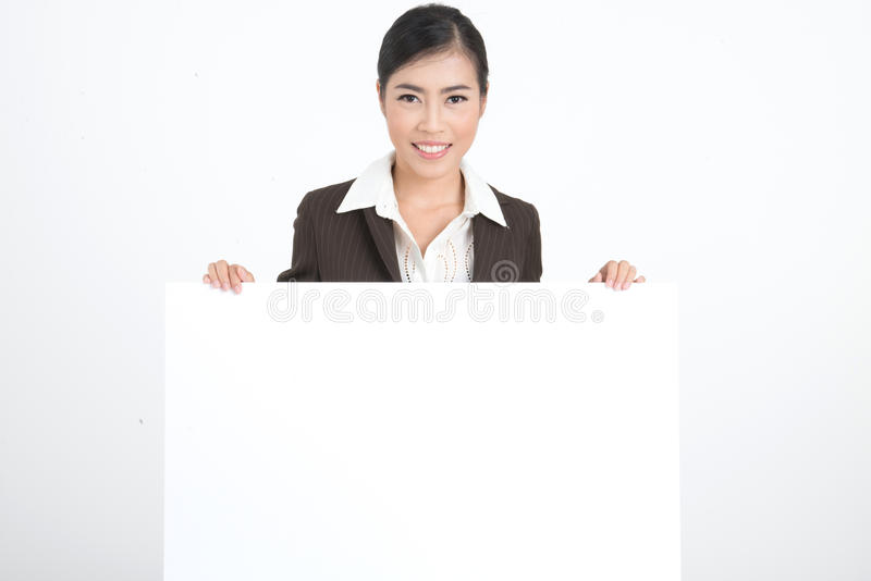 Business woman holding blank sign royalty free stock photography