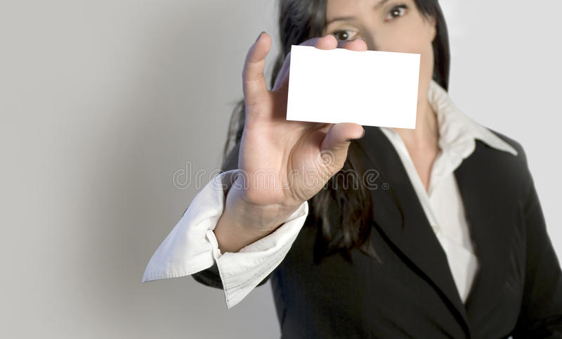 Business woman holding business card stock photography