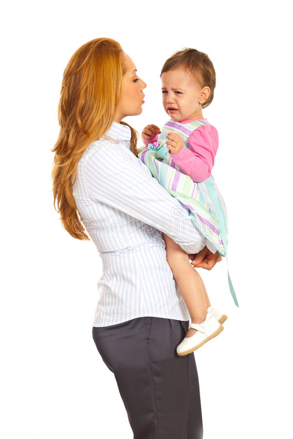 Business woman holding crying girl stock photo