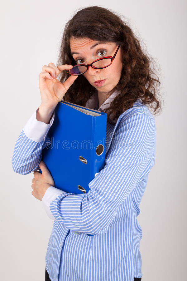 The business woman is holding a file in her hands stock images