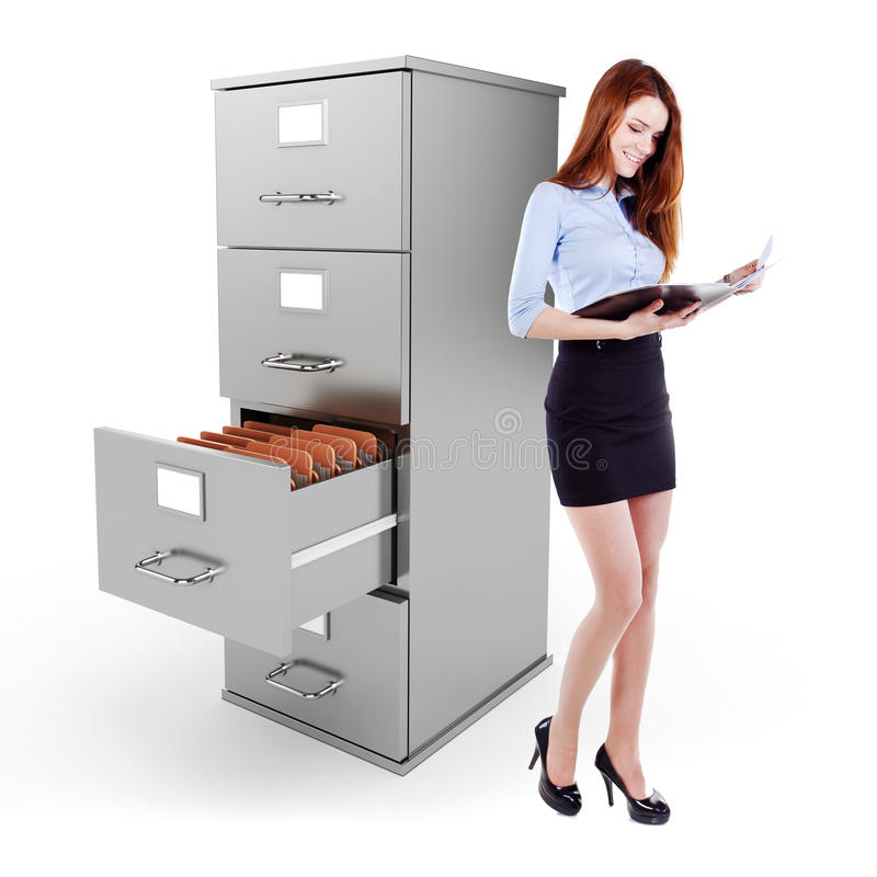 Business woman holding a file standing near a 3d file cabinet royalty free stock photo