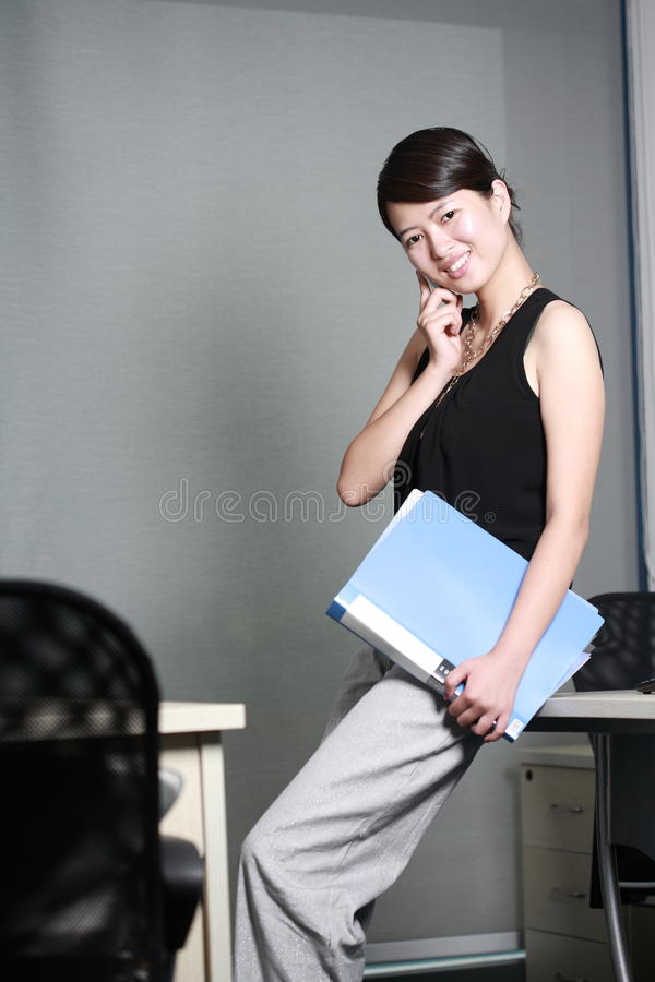 Download Business Woman Holding With Folder Stock Photo - Image: 14066298