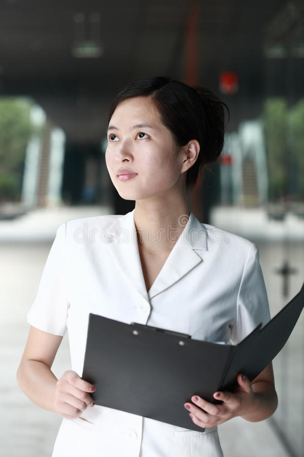 Business Woman Holding With Folder Royalty Free Stock Images