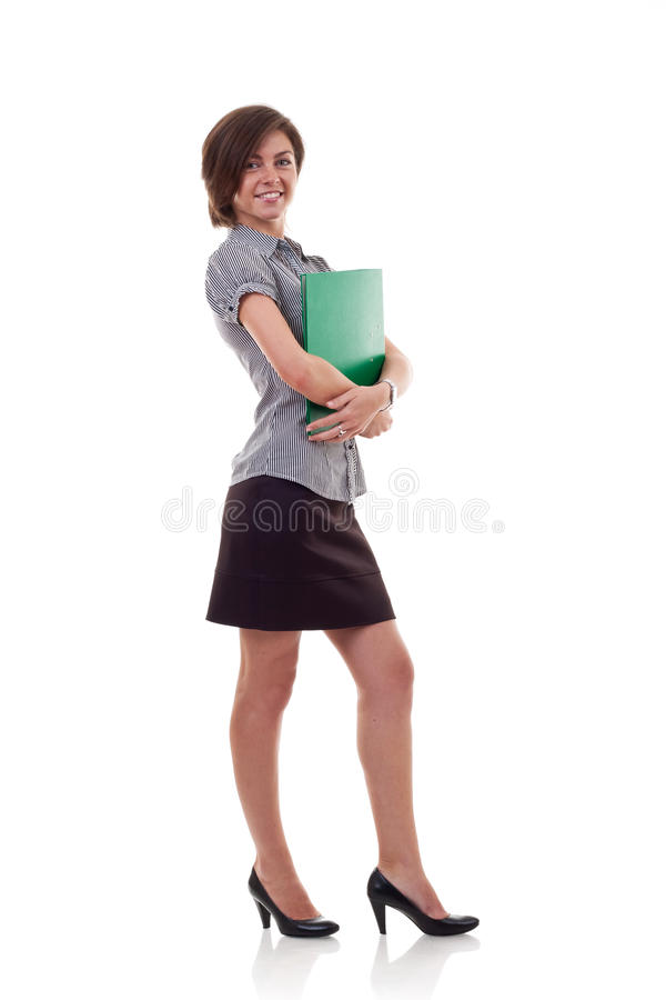Business woman holding a folder. Portrait of a beautiful young business woman holding a folder, full length royalty free stock photos