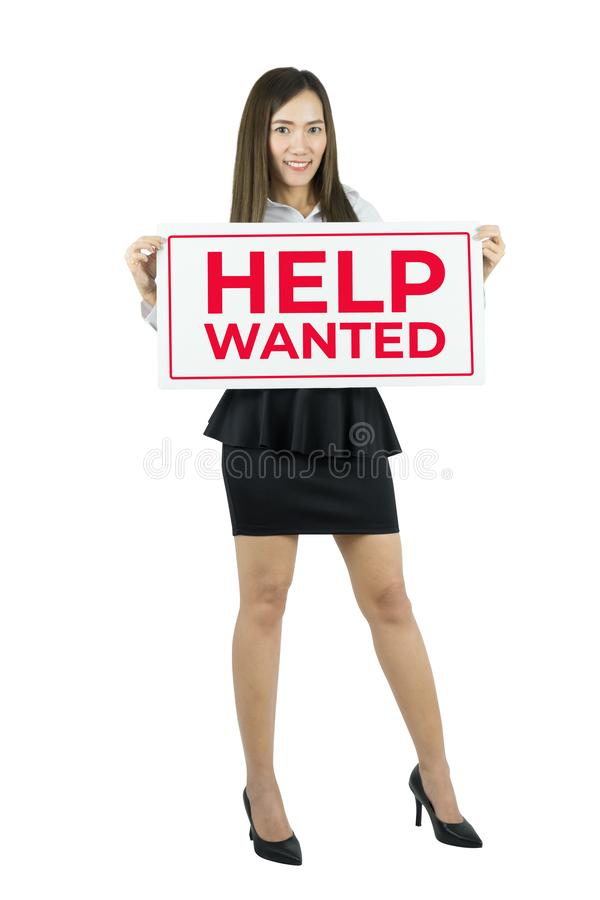 Business woman holding help wanted sign. Business woman showing placard. stock photo