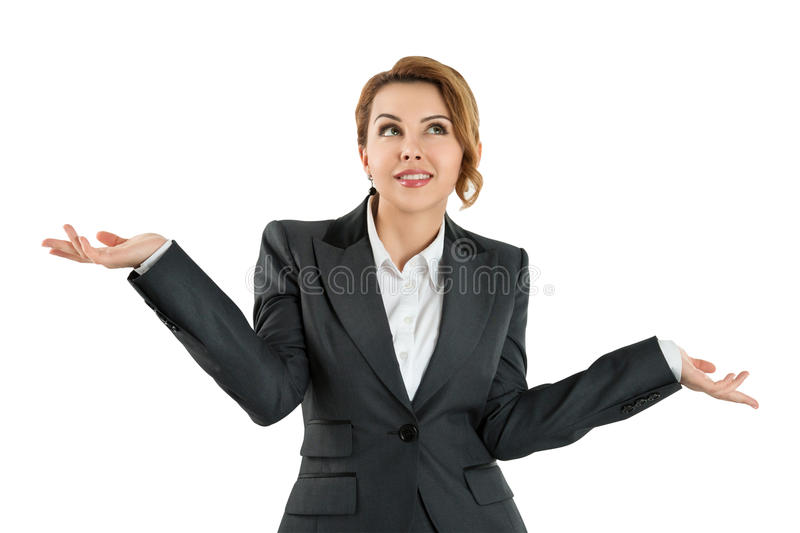 Business woman holding her hands out saying that she does not kn. Pretty business woman holding her hands out saying that she does not know isolated over white royalty free stock photo