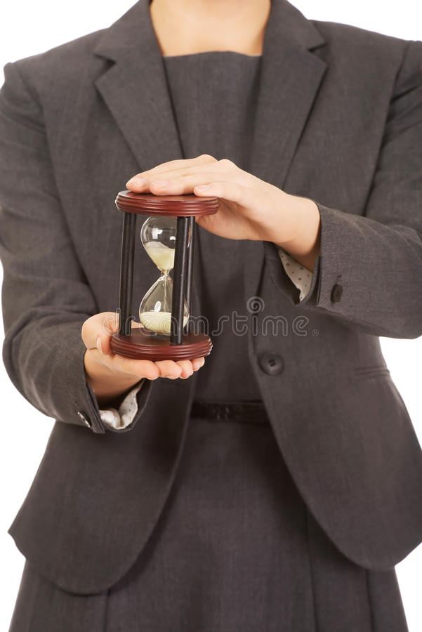 Business woman holding hourglass. Business woman hand holding hourglass royalty free stock photos