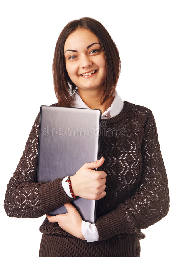 Business woman holding a laptop. Smiling business woman holding a laptop stock images