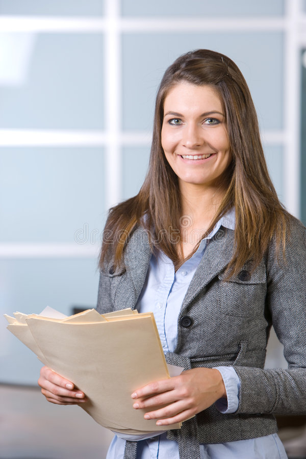 Business woman holding legal documents stock photo