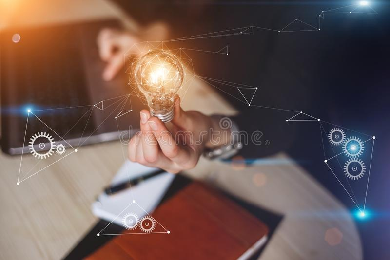 Business woman holding light bulbs. Innovation gears icon with network connection ideas with technology and creativity. royalty free stock photo