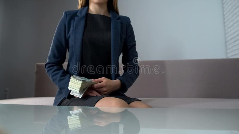Business woman holding money, buying real estate or investing in startup. Stock photo stock images