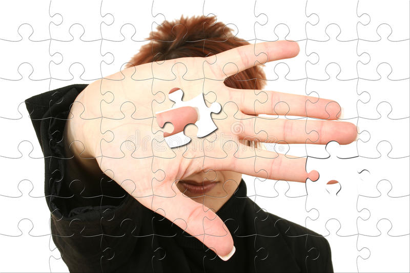 Business woman Holding Puzzle Piece In Hand stock photo
