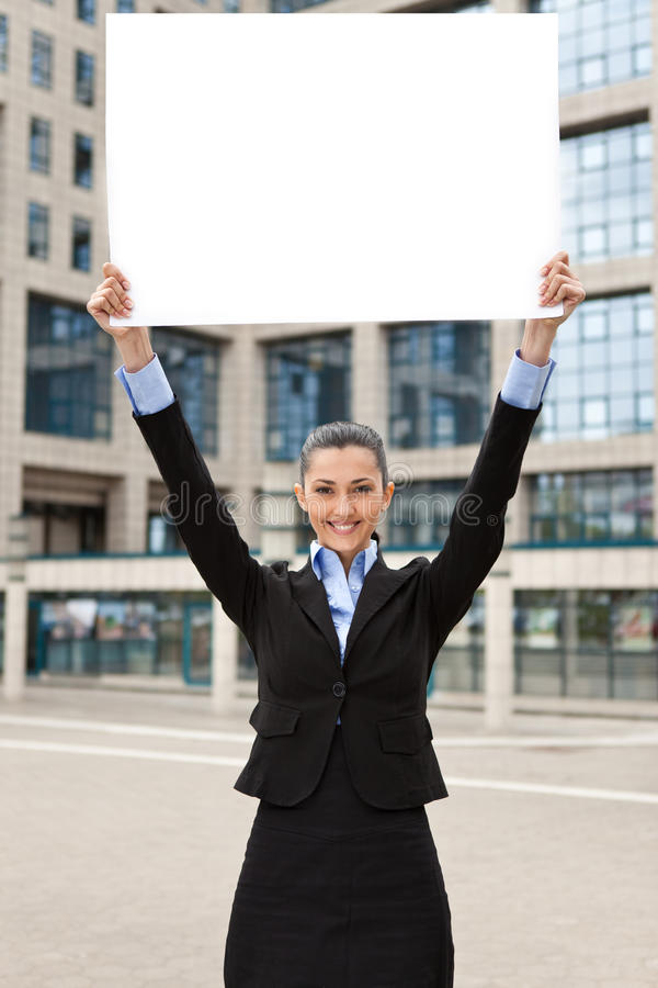 Download Business Woman Holding Raised Banner Stock Image - Image: 19693541