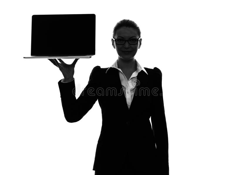 Business woman holding showing computer laptop silhouette stock images
