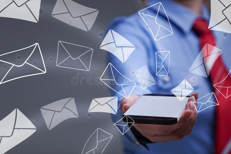 Business woman holding smartphone sending mail stock image