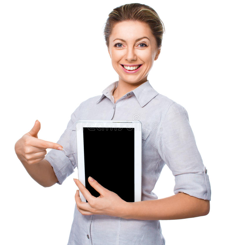 Business woman holding a tablet computer and showing on black screen on white background. Business woman holding a tablet computer and showing on black screen royalty free stock image