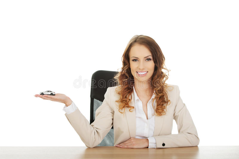 Business woman holding a toy car. royalty free stock photos