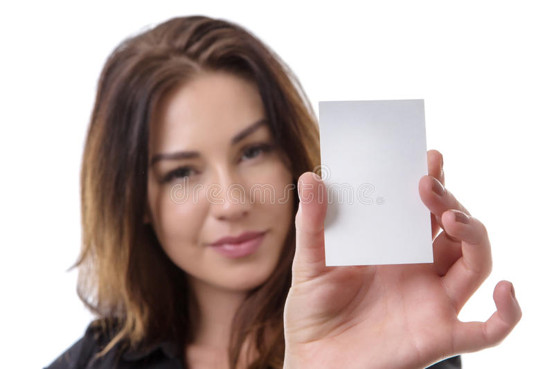 Business Woman holding white card. Close up shot of a pretty business woman holding a white blank card, isolated on white stock images