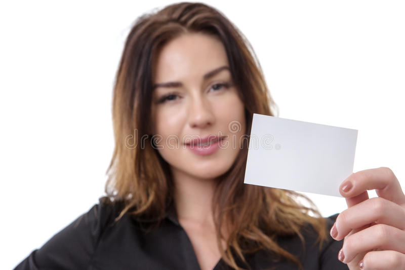 Business Woman holding white card. Close up shot of a pretty business woman holding a white blank card, isolated on white royalty free stock photography