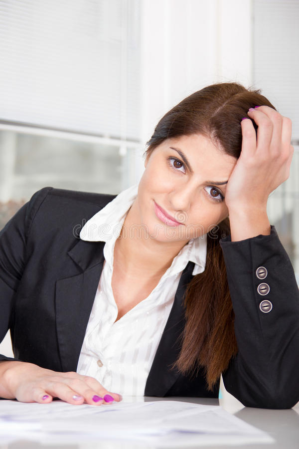 Business woman at home in suit stock photos